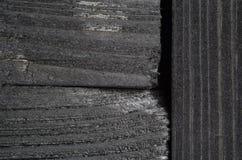 De donkere textuur van zwarte glanst hout Royalty-vrije Stock Foto's