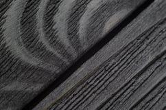 De donkere textuur van zwarte glanst hout Stock Fotografie