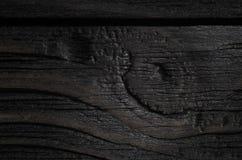 De donkere textuur van zwarte glanst hout Stock Foto