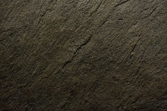 De donkere zwarte textuur van de kalksteensteen Stock Foto's