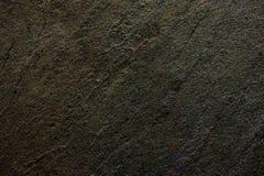 De donkere zwarte textuur van de kalksteensteen Royalty-vrije Stock Afbeeldingen