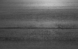 De donkergrijze stedelijke achtergrond van de asfaltweg Royalty-vrije Stock Afbeeldingen