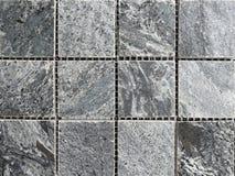 De donkergrijze textuur van de graniettegel Royalty-vrije Stock Afbeeldingen