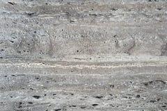 De donkergrijze textuur van de travertijnsteen Stock Foto