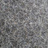 De donkergrijze textuur van de travertijnsteen Royalty-vrije Stock Fotografie