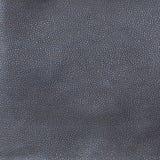De donkergrijze of zwarte achtergrond van de leertextuur Royalty-vrije Stock Afbeelding