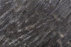 De donkergrijze of zwarte houten achtergrond van de textuurclose-up Stock Afbeeldingen