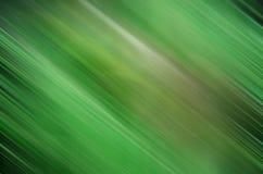 De donkergroene achtergrond van het motieonduidelijke beeld Stock Afbeeldingen