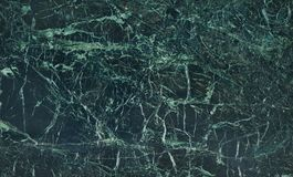 De donkergroene Marmeren natuurlijke achtergrond van de patroontextuur binnenland Stock Foto's