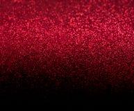 De donkerrode en zwarte achtergrond defocused Kerstmis Royalty-vrije Stock Afbeelding