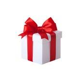 De doos van de gift met rode lint en boog Heden Stock Fotografie