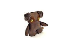 De douane handcrafted gevuld leerstuk speelgoed puppy - links Stock Afbeelding