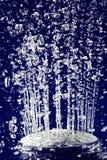 De doucheirrigatie van de hand met de tegengehouden dalingen van het motiewater Stock Afbeelding