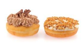 De doughnut en het brood met chocolade ranselden gewerveld Stock Fotografie