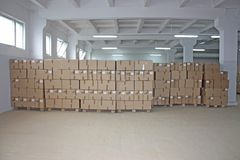 De dozenpakhuis van het karton stock afbeelding