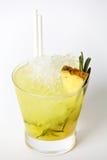 De drank van de ananascocktail met ijs en rozemarijn Stock Foto