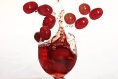 De dranken van de Druif van de plons Stock Afbeeldingen
