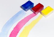 De drie primaire die kleuren met waterverf worden getrokken Stock Afbeeldingen