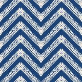 De driehoeks geometrisch naadloos patroon van de bandkleurstof royalty-vrije illustratie