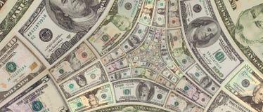 De driehoeksspiraal honderd, vijftig, tien van dollars geldamerikaanse dollars bankbiljetten Amerikaanse dollars als achtergrond  Royalty-vrije Stock Foto's