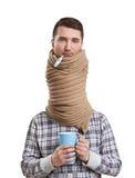De droevige mens in sjaal heeft een griep Stock Foto