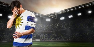 De droevige speler van Uruguay stock foto