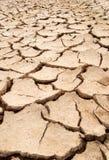 De droge textuur van modderbarsten stock afbeeldingen