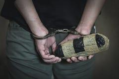 De drughandelaars werden gearresteerd samen met hun heroïne E royalty-vrije stock foto