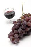 De druiven en het wijnglas van de cluster Stock Afbeelding