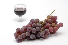 De druiven en het wijnglas van de cluster Royalty-vrije Stock Foto's
