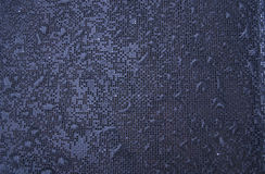 De druppels van de regen op een textuur Stock Foto's