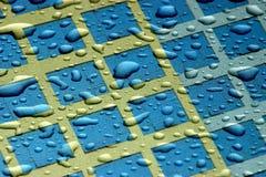 De Druppeltjes van het water op de Samenvatting van Vensters Stock Foto