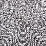 De druppeltjes van het water op een oppervlakte van concentrische cirkels Stock Foto