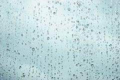 De druppeltjes van het water op venster Stock Foto's