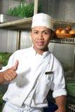 De duim van de chef-kok omhoog Stock Foto
