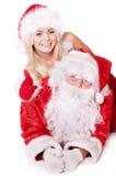 De duim van de Kerstman en van het meisje omhoog. Stock Afbeelding