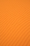 De duinen golvende textuur van het zand Stock Afbeelding