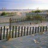 De Duinen van het zand bij Zonsondergang Stock Afbeeldingen
