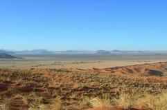De duinen van het zand in de woestijn van Kalahari Royalty-vrije Stock Foto