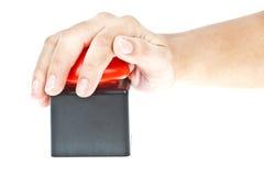 De duw van de hand op Rode knoop Royalty-vrije Stock Afbeelding