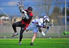 De duw van de Lacrosse van jongens royalty-vrije stock fotografie