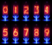 De echte Nixie-buisindicator een reeks decimale cijfers stock foto's