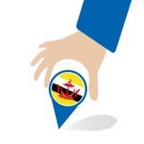 De Economische Gemeenschap van ASEAN, AEC in de speld van de zakenmanhand met Brunei, voor binnen aanwezig ontwerp Stock Foto