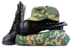 De eenvormige en twee legerlaarzen van de camouflage. Royalty-vrije Stock Foto