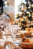 De eettafel van Kerstmis Stock Afbeeldingen
