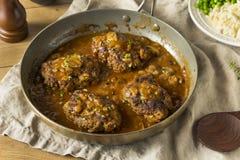De eigengemaakte Smakelijke Lapjes vlees van Salisbury stock afbeeldingen