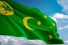 De Eilanden nationale vlag die van Cocoskeeling blauwe hemel realistische 3d illustratie golven als achtergrond vector illustratie