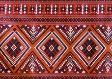 De elegante Thaise kunst op hand-woven stoffen Stock Fotografie
