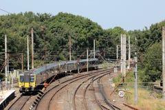 De elektrische Hoofdlijn met meerdere eenheden van de treinenwestkust Stock Foto