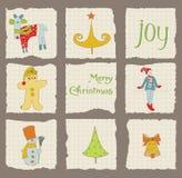 De Elementen van het Ontwerp van Kerstmis op gescheurd Document Stock Afbeeldingen